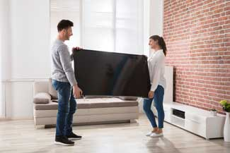 couple moving tv